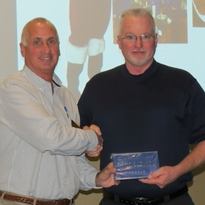 New Member Randall Hight with Planet Kidz Bears Night Out was presented with their membership plaque by President Sam Symonds at January 2016 General Meeting