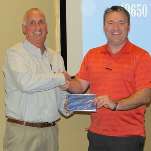 New Member Sam Smith with Priority Pay Systems was presented with his membership plaque by President Sam Symonds at January 2016 General Meeting
